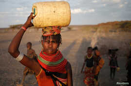 A woman carries a water canister in a village near Loiyangalani, Kenya, March 21, 2017.