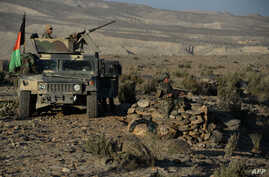 Afghan security forces take positions following an operation against Islamic State militants in Pachir Agam district of Nangarhar province, Dec. 3, 2016.