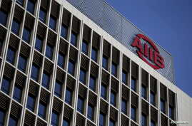 The logo of Asian Infrastructure Investment Bank (AIIB) is seen at its headquarter building in Beijing, Jan. 17, 2016.