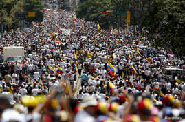 Opposition supporters march protest against Nicolas Maduro's government in Caracas, Venezuela, Feb. 22, 2014.