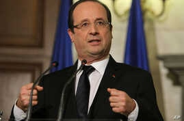 French President Francois Hollande gestures speaks during a news conference, February 19, 2013.