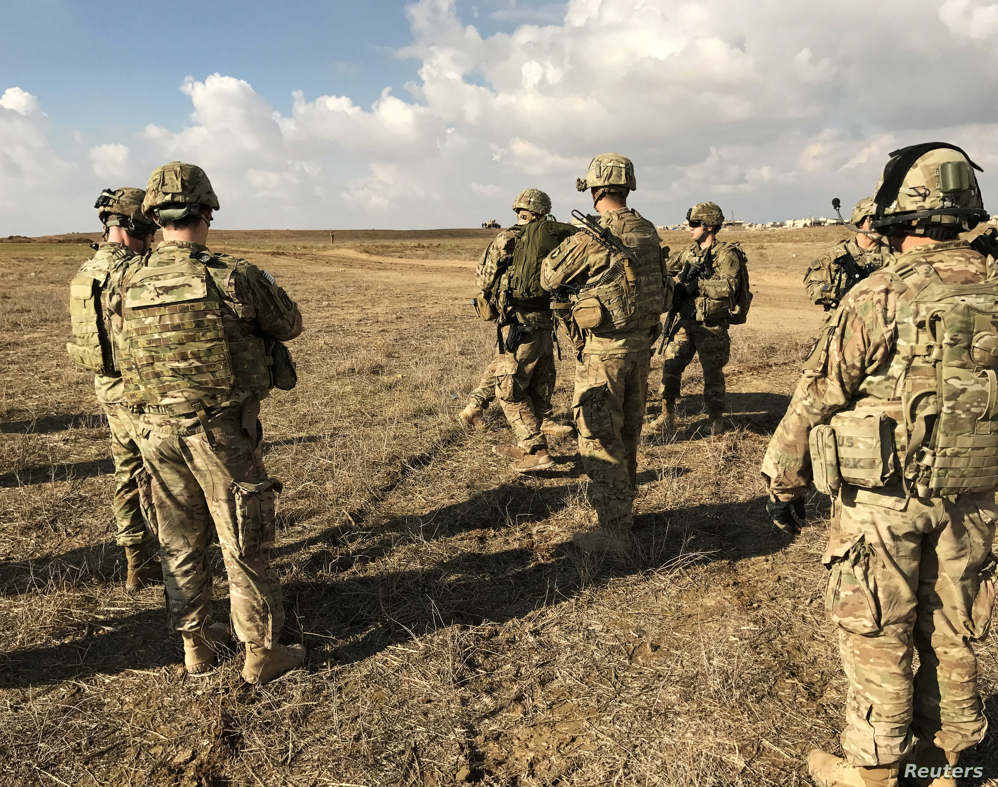 U.S. soldiers gather at a military base north of Mosul, Iraq, Jan. 4, 2017. The Pentagon has doubled the number of its military advisers in Iraq, brining the total to 450.