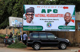 People stand near a sign for the All Progressive Congress (APC) national headquarters in Abuja, Nigeria, July 5, 2018.