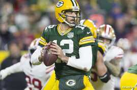 Green Bay Packers quarterback Aaron Rodgers looks to pass during the fourth quarter against the San Francisco 49ers at Lambeau Field in Wisconsin, Oct. 15, 2018.