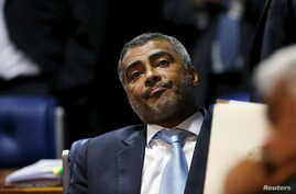 """Former Brazil striker and current senator Romario, pictured at the Brazilian Federal Senate in Brasilia, applauded U.S. efforts to crack down on alleged corruption within FIFA, saying, 'Thieves have to go to jail,"""" May 27, 2015. May 27, 2015."""