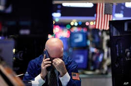 A trader talks on his phone on the floor of the New York Stock Exchange, Jan. 2, 2019.