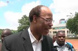 Mel Reynolds smiled as he walked past journalists and into Zimbabwe's Harare courthouse.