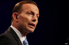 FILE -  Australia's Prime Minister Tony Abbott speaks to the media during a press conference at the conclusion of the G-20 summit in Brisbane, Australia.
