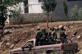 Syrian Troops, Tanks Ease Grip on Defiant Border Town