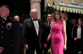 President Donald Trump and first lady Melania Trump arrive for the 60th annual Red Cross Gala at Trump's Mar-a-Lago resort in Palm Beach, Florida, Feb. 4, 2017.