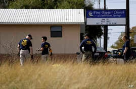 Law enforcement officials investigate the scene of a shooting at the First Baptist Church of Sutherland Springs, Nov. 6, 2017, in Sutherland Springs, Texas.
