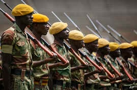 Members of the Zimbabwean military parade during a dress rehearsal for Friday's presidential inauguration of Emmerson Mnangagwa, at the National Sports Stadium in Harare, Zimbabwe, Nov. 23, 2017.