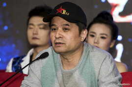 FILE - Bi Fujian, an anchor of China Central Television (CCTV), speaks during a news conference in Beijing.