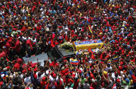 The coffin of Venezuela's late President Hugo Chavez is driven through the streets of Caracas after leaving the military hospital where he died of cancer in Caracas, March 6, 2013.