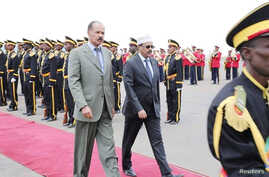 Eritrea's President Isaias Afwerki, left, walks beside Somalia's President Mohamed Abdullahi Mohamed during a welcoming ceremony upon his arrival for a three-day visit to Eritrea, in Asmara, Eritrea, July 28, 2018.