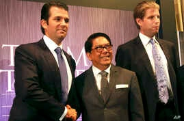 Philippines Trump TowerDonald Trump Jr., left, and Eric Trump, right, sons of Donald Trump, pose with local developer Jose E. B. Antonio at the launching of Manila's Trump Tower project June 26, 2012 in the Philippines.