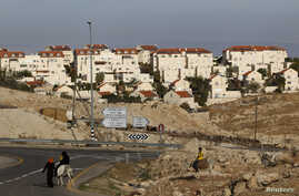 Bedouins ride donkeys in the West Bank Jewish settlement of Maale Adumim, near Jerusalem December 3, 2012. Israel will not backtrack on a settlement expansion plan that has drawn strong international condemnation, an official in Prime Minister Benjam