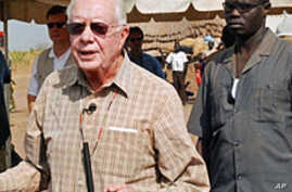 Former US president Jimmy Carter (L) during a press conference in the southern Sudanese village of Lojora , 11 Feb 2010
