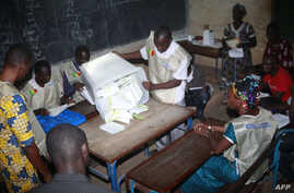 Electoral agents count the votes at a polling station on July 28, 2013 in the Malian capital Bamako.