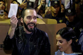 Presidential candidate Nayib Bukele of the Great National Alliance (GANA) casts his vote next to his wife Gabriela Rodriguez during the presidential election in San Salvador, El Salvador, February 3, 2019.