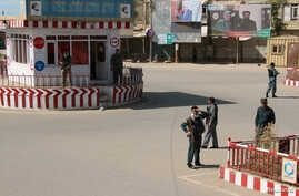 Afghan policemen keep watch at the downtown of Kunduz city, Afghanistan, Oct. 3, 2016.