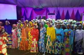 Chibok girls entertain guests during their send forth dinner at A Class garden in Abuja, Nigeria. The girls will commence a special foundation program at American University of Nigeria Yola .