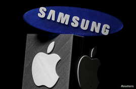 In a verdict reached May, 24, 2018, a jury said Samsung must pay Apple $539 million in damages for illegally copying some of the features of the iPhone. The Samsung and Apple logos are seen in this illustration made in Zenica, Bosnia and Herzegovina,