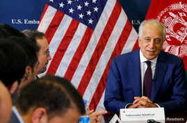 U.S. special envoy for peace in Afghanistan, Zalmay Khalilzad, talks with local reporters at the U.S. embassy in Kabul, Afghanistan, Nov. 18, 2018. (U.S Embassy handout via Reuters)