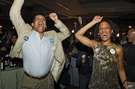 Roland and Natalie Jones celebrate as President Barack Obama is predicted as the winner over challenger Mitt Romney at a Colorado Democrat's election party at the Sheraton Hotel in Denver on Nov. 6, 2012.