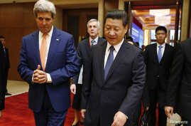 "U.S. Secretary of State John Kerry (L) talks with China's President Xi Jinping after the Joint Opening Session of the U.S.-China Strategic and Economic Dialogue known as the ""S&ED"" at the Diaoyutai State Guesthouse in Beijing, July 9, 2014."
