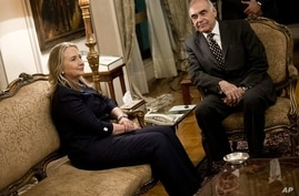 Egyptian Foreign Minister Mohammed Kamel Amr, right, holds talks with US Secretary of State Hillary Clinton in Cairo, July 14, 2012.