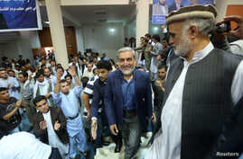 Afghan presidential candidate Abdullah Abdullah arrives for a gathering with his supporters in Kabul, July 8, 2014.