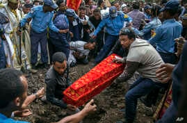The coffin of one of those killed in the collapse of a mountain of trash at a garbage dump arrives for burial at the Gebrekristos church in Addis Ababa, Ethiopia, March 13, 2017.