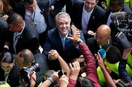 Ivan Duque, candidate of the Democratic Center party, greets supporters after voting during a presidential election in Bogota, Colombia, June 17, 2018.
