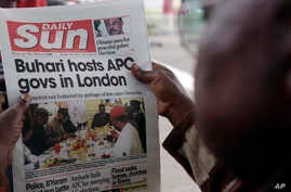 FILE - In this Monday, July. 24, 2017 file photo, a man reads a story about Nigeria's President Muhammadu Buhari after the government released a photo of Buhari more than two months after he left for London for medical treatment, in Lagos, July 24, 2