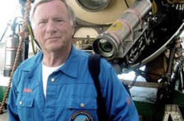 Donald Walsh in front of the Russian Mir Submersible after diving to the World War II German battleship Bismarck.