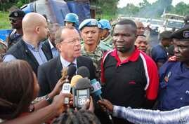 MONUSCO Chief Martin Kobler (wearing suit) with North Kivu governor Julien Paluku (wearing red) at the ambush site in Beni territory, eastern Congo, May, 2015. (Nicholas Long/VOA)