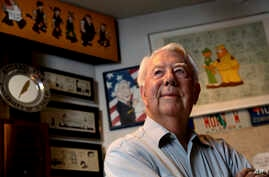 FILE - Mort Walker, the artist and author of the 'Beetle Bailey' comic strip, stands in his studio in Stamford, Conn. On, Jan. 27, 2018, a family member said Walker had died at age 94.