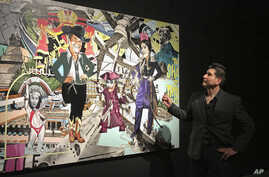 Border artist Claudio Dicochea explains one of the paintings in his 'Acid Baroque' exhibit on display at the Scottsdale Museum of Contemporary Art in Scottsdale, Ariz., through May 20.