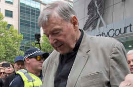 Cardinal George Pell leaves the County Court in Melbourne, Australia, Feb. 26, 2019. The most senior Catholic cleric ever charged with child sex abuse has been convicted of molesting two choirboys.