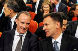 Secretary of State for Existing the European Union Dominic Raab, left and Secretary of State for Foreign and Commonwealth Affairs Jeremy Hunt, right, in the audience before Conservative Party Leader and Prime Minister Theresa May speech at the Conser