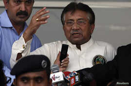 Pakistan's former president, Pervez Musharraf, addresses a group of supporters following his arrival in Karachi March 24, 2013.