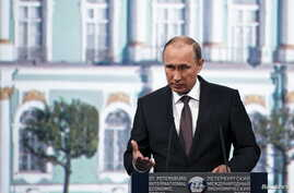 Russian President Vladimir Putin speaks during a session of the St. Petersburg International Economic Forum 2015, St. Petersburg, Russia, June 19, 2015.