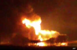 A picture taken from video from the news station Noticias Ciudad del Carmen shows a fire burning at an oil platform in the Gulf of Mexico along the Mexican coast before sunrise on April 1, 2015.