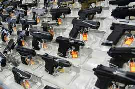 In this photo taken on Feb. 16, 2018, guns are for sale at the South Florida Gun Show at the Dade County Fairgrounds in Miami. The US House of Representatives on Feb. 27, 2019, passed its first major gun safety measure in a quarter century.