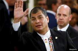Ecuador's President Rafael Correa waves as he arrives for the taking office ceremony of Argentina's President Mauricio Macri at Casa Rosada Presidential Palace in Buenos Aires, Argentina, Dec.10, 2015.