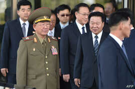 N. Korean Hwang Pyong-So (2L), director of the military's General Political Bureau, the top military post in North Korea, walks with officials including Ryong-Hae (R), a top secretary of the North's ruling Workers' Party of N. Korea (2R) as they leav