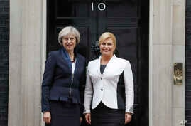 Britain's Prime Minister Theresa May, left, welcomes President Kolinda Grabar-Kitarovic of Croatia to No 10 Downing Street in London, on Oct. 11, 2016.