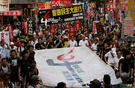 June 4 marks the 25th anniversary of China's bloody crackdown on Tiananmen Square. Thousands of people march on a downtown street in Hong Kong, June 1, 2014.