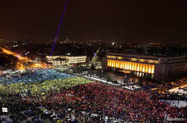 Protesters display the Romanian national flag colors during a demonstration in front of the government building in Bucharest, Romania, Feb. 12, 2017.